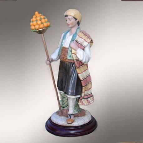 Figura de porcelana, Valenciano Saragüel con piñata de naranjas con peana, serie limitada