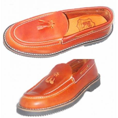 moccasins. leather boat shoe. with tassels. handmade. classic design. resistant. exclusivity